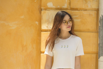 Portrait of thai chinese adult beautiful girl Denim blue travel relax and smile