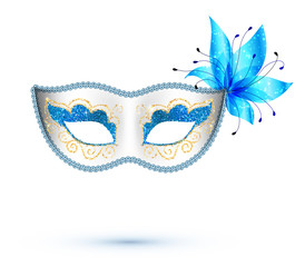 White carnival mask with blue flower and golden glitter