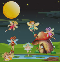 Fairies flying over the house at night