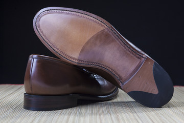 Footwear Concepts and Ideas. Backside View of Penny Loafer Natural Leather Sole Closeup