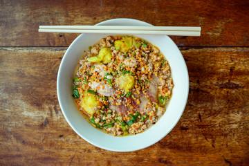 Noodles pork dumplings,spicy soup thai style