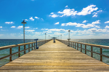 Spectacular perspective view of the famous Anglins Fishing Pier in a sunny day with blue sky, Lauderdale by the Sea, 30 miles from Miami, Florida, United States.