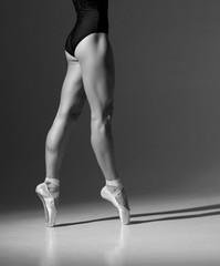 Beautiful legs of a young and graceful ballerina