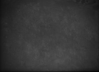 Empty blank black chalkboard with chalk traces.