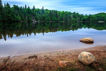 Reflection in beautiful lake Algonquin Provincial Park, Ontario, Canada