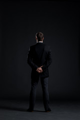 Businessman on a black background