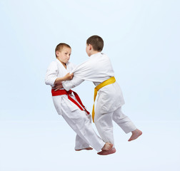 Boys in judo are training capture for throw