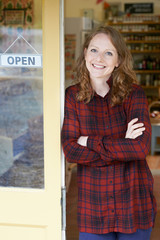 Portrait Of Female Delicatessen Owner Outside Store