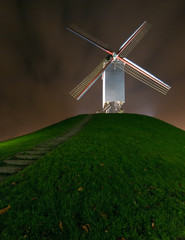 Cornmill in Bruges by night in Bruges, Belgium