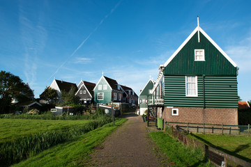 One of the cozy small streets of Marken, a rural village in the North of Holland at the Ijsselmeer.