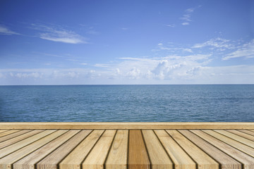 Empty top wooden table and beautiful peace sea in background. Can use for product display