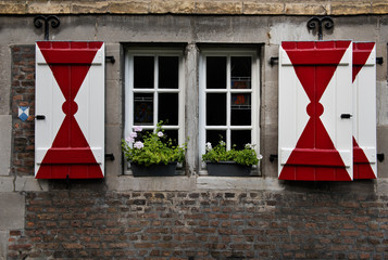 A medieval house in Maastricht with characteristic red & white shutters