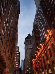 Streetview of the Financial District in Manhattan, New York at night.