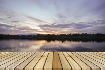 Empty top wooden decking and sunset moment at little lake background. Can use for product display