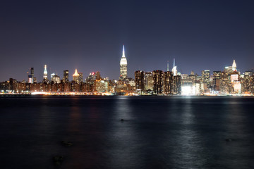 Manhattan illuminated at night, taken from Brooklyn