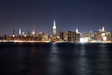 Manhattan illuminated at night, taken from Brooklyn