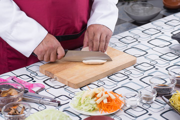 Chef slicing tofu for cooking