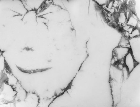 Surface of natural mineral howlite, picture in the stone resembles a human face.