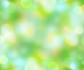 Green blur shining natural background.Easter wallpaper.