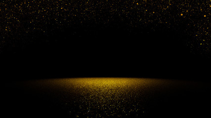 twinkling golden glitter falling on a flat surface lit by a bright spotlight
