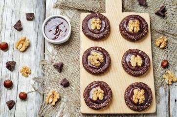 Raw vegan chocolate dates hazelnut cookies with chocolate frosti