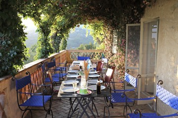 dinner on a wonderful terrace in summer at sunset