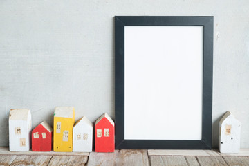 blank poster frame on table