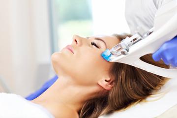 Woman having facial mesotherapy in beauty salon