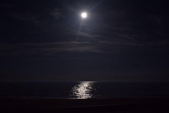 Ocean Beneath the Moonlit Sky