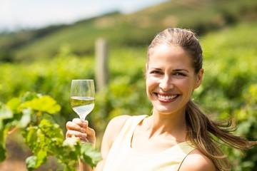 Portrait of female vintner holding wine glass