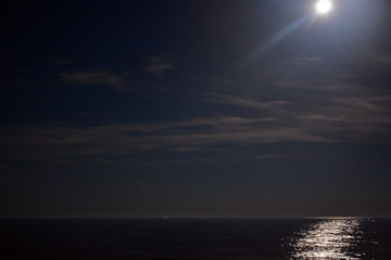 Glowing Moon above the Ocean