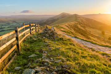 Mountain Path Bathed In Golden Sunlight In The Peak District, UK.