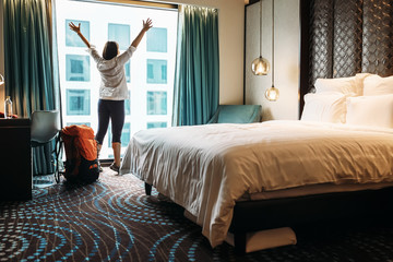 Fototapeta Backpacker traveller happy to stay in five star hotel obraz