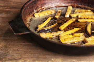 Eggplant on frying pan, closeup