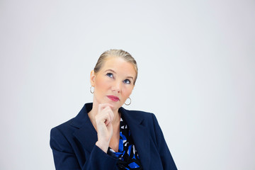 Business Woman with Hand On Chin Looing Up