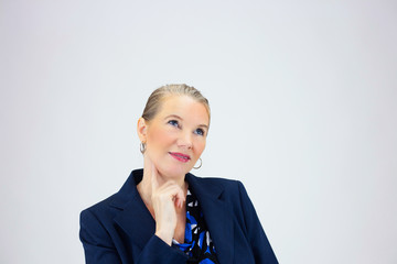 Business Woman with Finger Under Chin