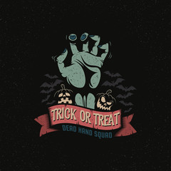 Dead Man's Hand with a Halloween pumpkin, ribbon and bats. Trick or treat logo October 31. Vector illustration. A layered.