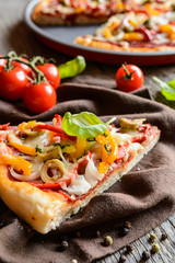 Salami pizza with green olives, pepper, onion and Edam cheese