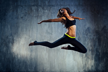 Young sports woman jumping