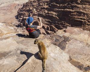Women takes photo on High Place of Sacrifice. Petra. Jordan.