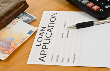 blank loan application is on the table