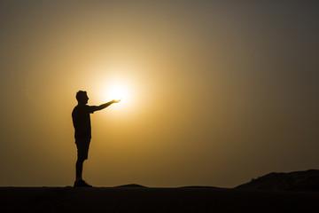 man holding a sun