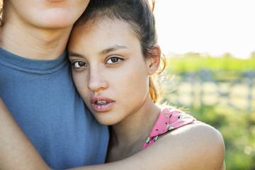 Close-up of a young woman embracing her boyfriend