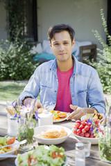 Man enjoying meal outdoors, portrait