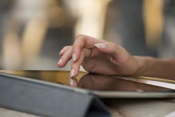 Woman's hand using digital tablet