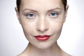 Young woman wearing red lipstick, close-up