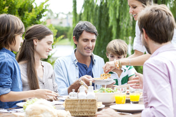Family eating together at outdoor gathering
