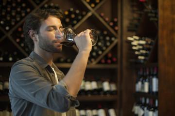Sommelier tasting glass of wine