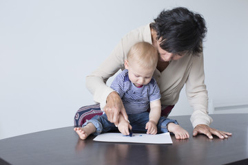 Grandmother drawing with baby