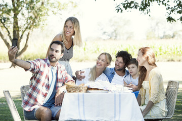Family taking selfie while sitting outdoors